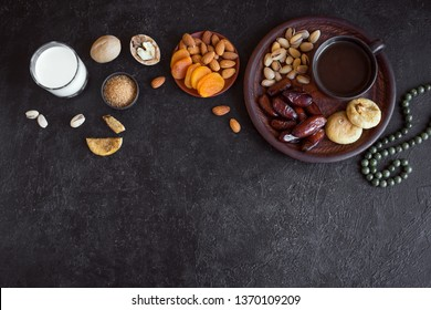 Traditional Muslim Iftar Food, copy space. Ramadan kareem with premium dates, nuts, dried fruits and coffee. Ramadan iftar food concept with rosary.