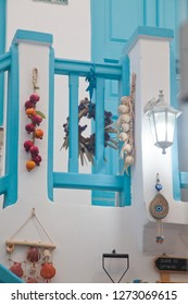 traditional narrow street in Mykonos with blue doors and white walls