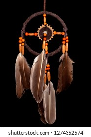 Traditional native dreamcatcher isolated on black.