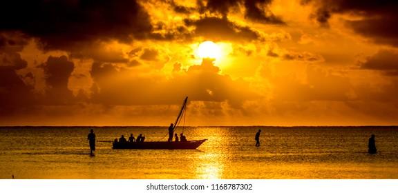 A traditional native nagalawa at sunrise. The ngalawa or ungalawa is a traditional, double-outrigger canoe of the Swahili people living in Zanzibar