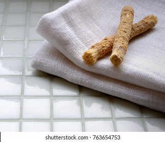 Traditional natural toothbrush Miswak or Siwak (Salvadora persica) and a linen towel. Selective focus.