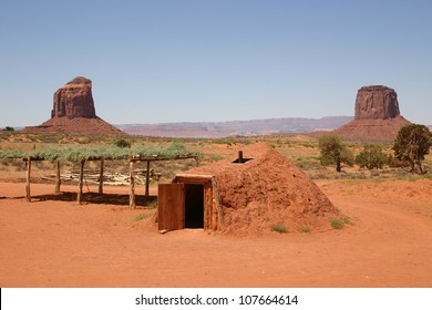 A traditional Navajo home, known as a hogan sits in the center of Monument Valley, Arizona.