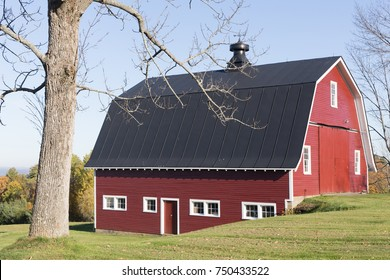Traditional New England red barn on a farm.