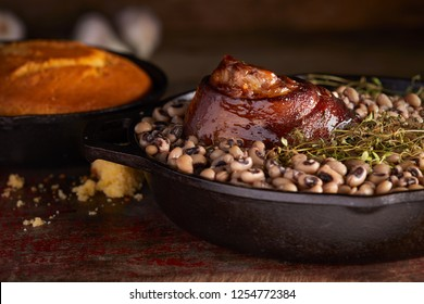 Traditional New years meal black eyed peas and ham hock with cornbread.
