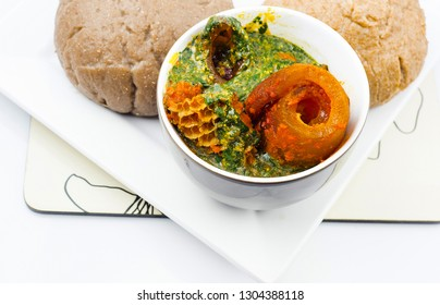 Traditional Nigerian Meal - Ewedu, Gbegiri and assorted meat served with wheat meal