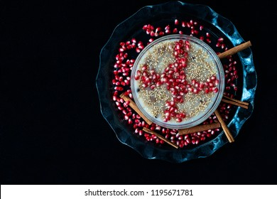 Traditional Noah's pudding. Asure bowl on black background.