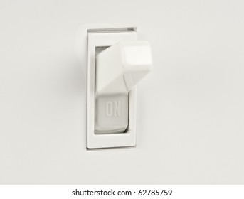 Traditional North American toggle electric light switch in ON position macro shot