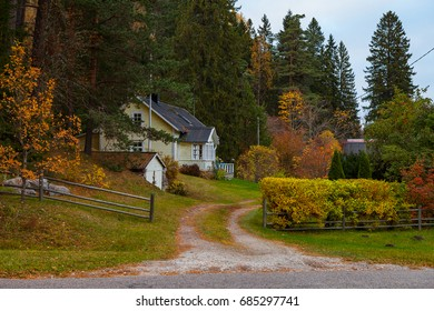 Traditional Northern European house surrounded by fall foliage. Estonia.
