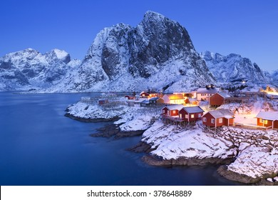 Traditional Norwegian fisherman's cabins, rorbuer, on the island of Hamnoy, Reine on the Lofoten in northern Norway. Photographed at dawn in winter.