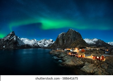 Traditional Norwegian fishing cottages, huts, island Hamnøy, Reine in Lofoten in northern Norway. Photographed at dawn in winter.