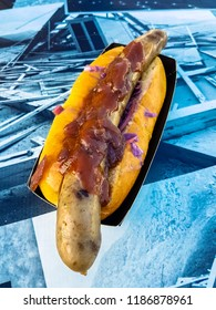 A traditional Norwegian hot dog, with onions and pickled beetroot and gherkins