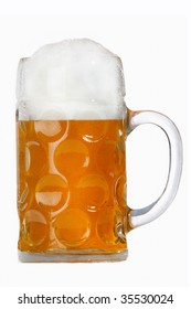A traditional Oktoberfest beer in a Wiesn mass glass on white.