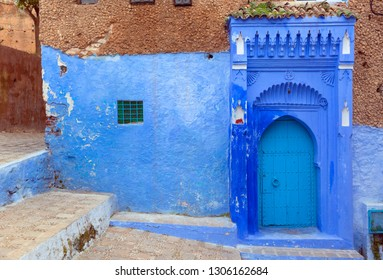 Traditional old blue door on street inside Medina of Chefchaouen, Morocco