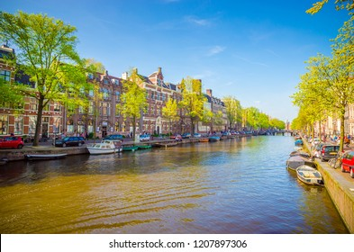 Traditional old buildings and boats in Amsterdam, Netherlands