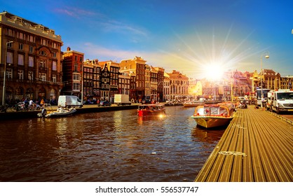Traditional old buildings and and boats in Amsterdam, Netherlands. Canals of Amsterdam