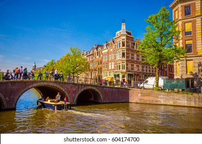Traditional old buildings and and boats in Amsterdam, Netherlands