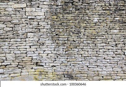 traditional old dry stone wall in cotswolds village of bilbury gloucestershire england
