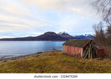 traditional old fisher hut and cottage at norwegian fjord, rorbuer