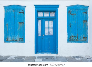 Traditional old greek house with blue door and windows