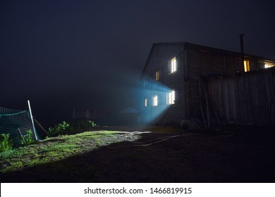 Traditional old house in the evening. Lights from the window makes the scene as if it is from scary / horror / thriller movie. Taken in Heba Plateau, Artvin, Karadeniz / Black Sea region of Turkey