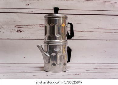 Traditional old Italian Neapolitan coffee maker or flip pot for brewing coffee with boiling water with dents in the metal
