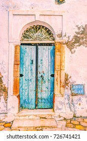 Traditional old painted door in a historical district or medina, Tunisia. Colorful textured image of muslim architecture.