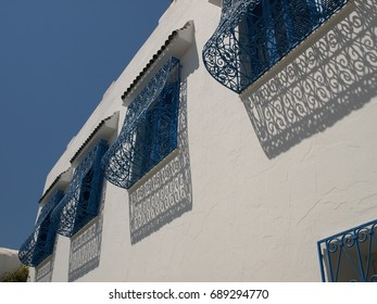 Traditional old painted window in a historical district or medina, Tunisia. Colorful textured image of muslim architecture.