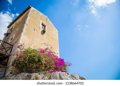 Traditional old Sicilian house during a sunny day with a wonderful blue sky background.