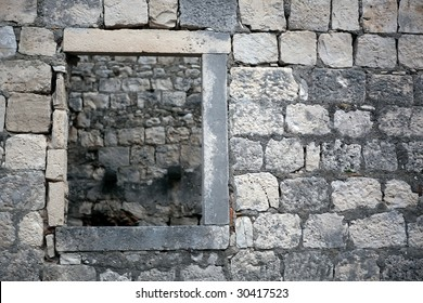Traditional old stone window ruined. Can be used ad old medieval background with frame. Location: Korcula island, Croatia