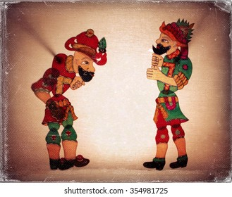 Traditional Old Turkish Ottomans shadow theater ( Galanty show ) Hacivat and Karagoz. Vintage style,  worn photo paper look image.