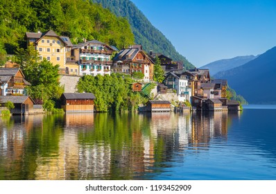 Traditional old wooden houses in famous Hallstatt mountain village at Hallstattersee lake in the Austrian Alps in summer, region of Salzkammergut, Austria
