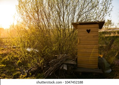 Traditional old wooden outhouse in the garden in summer
