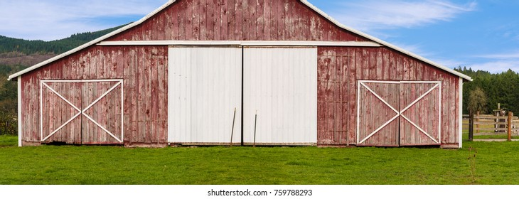 Traditional Old Wooden Red Barn and White Doors Panoramic