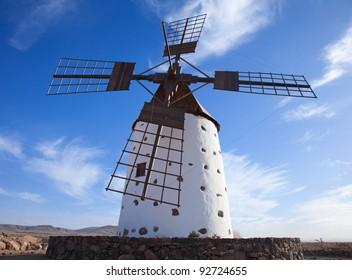 Traditional older style round windmill (molino) close to El Cotillo Village in La Oliva municipality  of Fuerteventura, Canary Islands