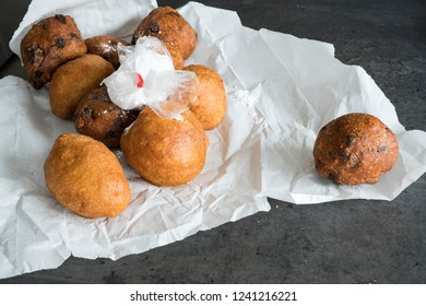 traditional oliebollen, oil dumpling or fritter, in paper bag, for Dutch New Year's Eve