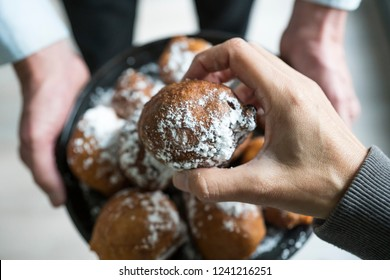 traditional oliebollen, oil dumpling or fritter, treat for Dutch New Year's Eve