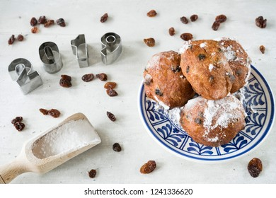 traditional oliebollen, oil dumpling or fritter, on blue plate, for Dutch New Year's Eve 2019