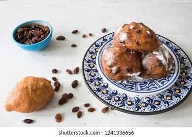 traditional oliebollen, oil dumpling or fritter, on blue plate, for Dutch New Year's Eve