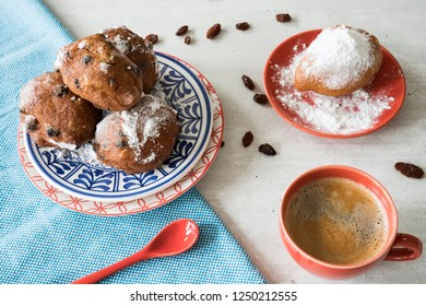 traditional oliebollen, oil dumpling or fritter, on plate, for Dutch New Year's Eve