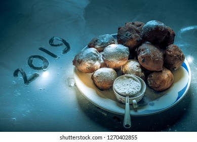 Traditional oliebollen, oil dumpling or fritter, with powdered sugar, a typical Dutch New Year's Eve tradition.