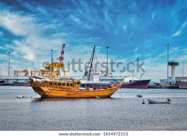 traditional-omani-dhow-anchored-port-600