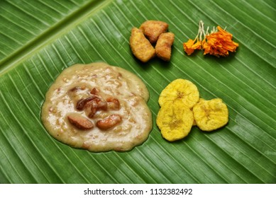 Traditional Onam Sadhya boiled rice served with curries Parippu, Sambar, Rasam, Pulisseri, Kaalan, Avial, Thoran, Olan, Pachadi, Naranga, Papadum, Payasam, Banana, Yogurt, Buttermilk, chips in Kerala.
