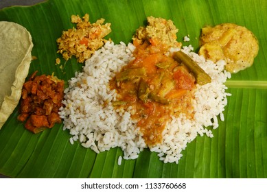 Traditional Onam Sadhya boiled rice served with curries Parippu