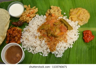 Traditional Onam Sadhya boiled rice served with curries