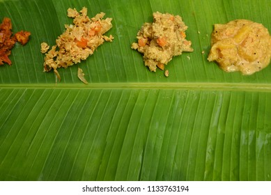 Traditional Onam Sadhya on banana leaf with copy space, Kerala India. Big feast on Indian festival and marriages.