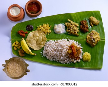Traditional Onam Sadya served on a banana leaf on Festival day in Kerala