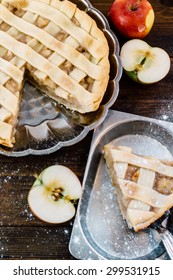 traditional open vegetarian apple pie on wooden table in rustic style