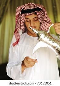 Traditional oriental arabic custom of pouring coffee