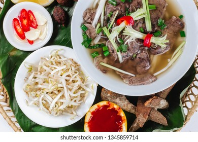 Traditional oriental cuisine of  Vietnam. Pho bo soup with rice noodles, beef, pepper, wheat germ, greens