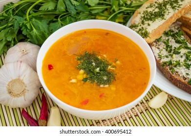 Traditional oriental soup with tomatoes, red lentils, green